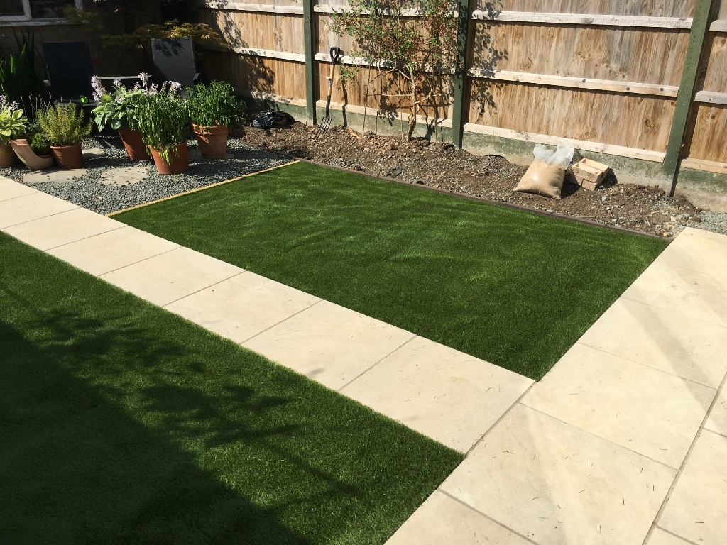 Domestic hard and soft landscaping patio and turf