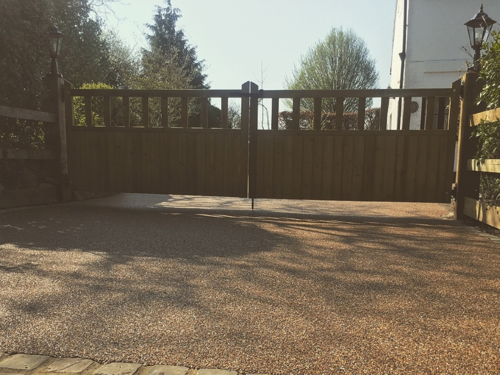 Domestic hard landscaping Driveway entrance gates with resin-bound driveway
